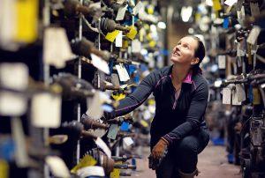 female mechanic working at storage